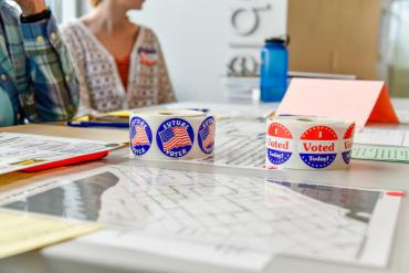 I Voted and Future Voter stickers on table at polling place