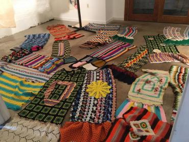 Sections of the poll wraps for the yarn bombing project Women Take the Polls