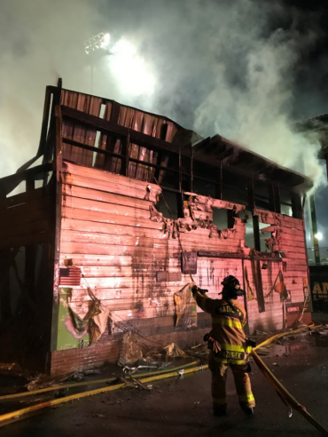Mallards pro shop exterior with fire damage