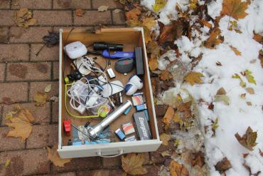 """Junk Drawer"" containing miscellaneous items"