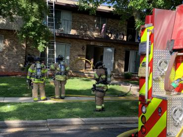 Firefighters outside building on E. Karstens Drive