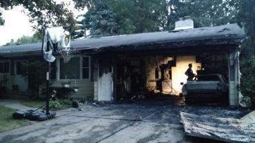 Investigators examine fire scene.