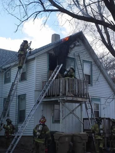 Laddering fire building at E. Mifflin St.
