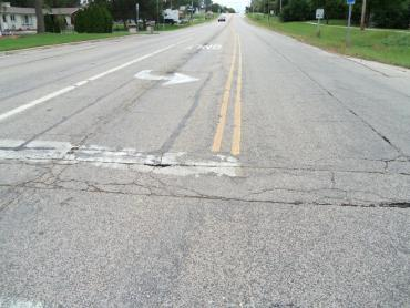 Photo shows deteriorating pavement on Cottage Grove Road.