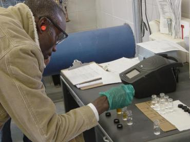 Madison Water Utility employee tests water sample at a well
