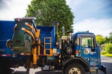 Recycling truck dumping a cart