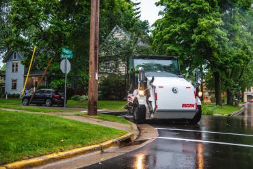 Street sweeper rounding a corner in the Monroe Street neighborhood