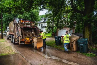 Two Streets Division employees emptying trash carts