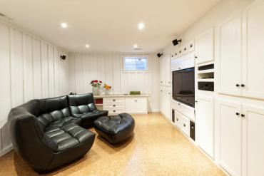Basement family room with couch and TV