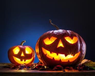 Grinning pumpkins destined for the composter by placing them into your leaf piles at the curb