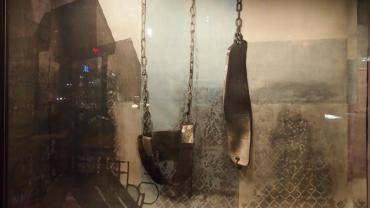 """Image of Tyanna Buie's storefront window installation at 341 State Street. Title """"This is only a Façade"""""""