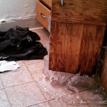 Burst pipe behind cabinet