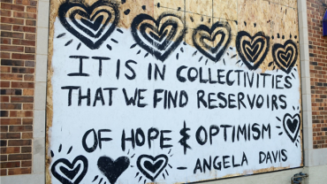 """Street art from State Street says, """"It is in collectivities that we find reservoirs of hope and optimism""""-Angela Davis"""