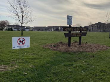 dog free park sign