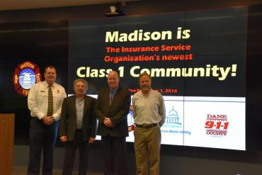 Chief Davis, Mayor Soglin, Dane County 911 Asst. Operations Manager Kevin Fosso, and Madison Water Utility GM Tom Heikkinen