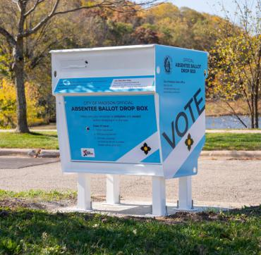 Blue and white absentee ballot drop box in the City of Madison. Drop box is located near the pond at Elver Park on the city's west side.