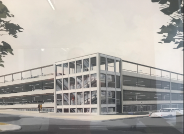 Government East Garage then and now:  Rendering of garage prior to original construction