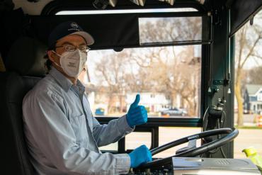 Metro driver wearing a mask.