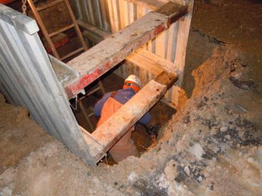 Water Utility employee works to repair broken main