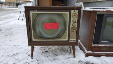 Very old television ready to be recycled at 1501 W. Badger Rd with $15 recycling sticker.