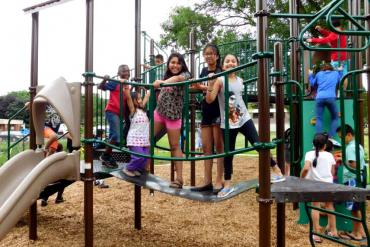 Kids enjoy the new Play for Peace Playground in Bayview