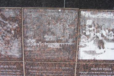 Detail of Spirit of Greenbush granite image and story panel showing how unreadable the stones in the base became over time.