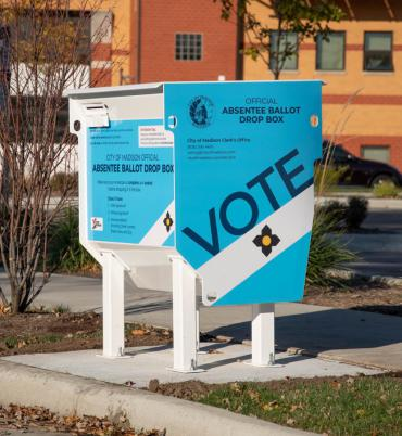 Image of a secure absentee ballot drop box outside City of Madison Fire Station 6 on Perry Street.
