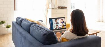 Person working from home participating in a virtual meeting