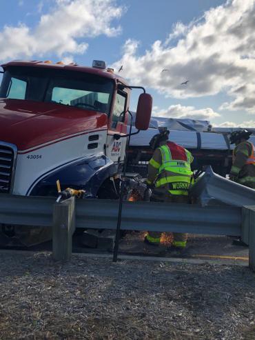 Firefighter cuts away guard rail using K12 saw