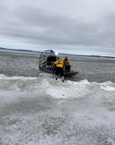 Lake Rescue Team placing swan into ice boat