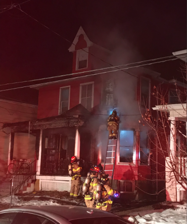 Firefighters in front of house on Franklin Street