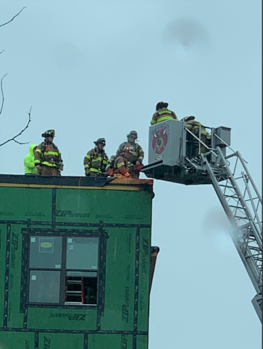 Aerial platform next to rooftop where fire occurred