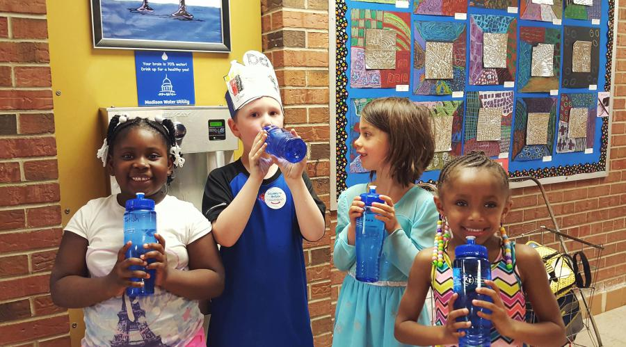 Students fill bottles at Lindbergh Elementary hydration station