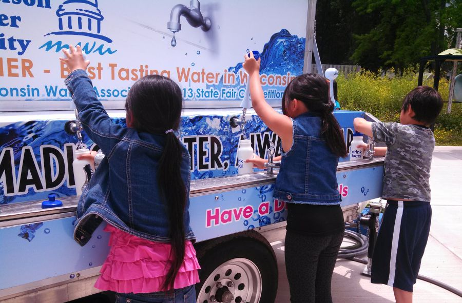 Children get water from the Water Wagon