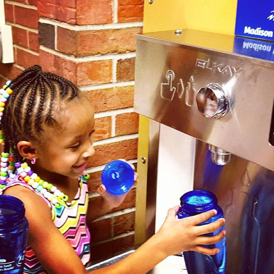 Girl stops by refilling station at Lindbergh Elementary