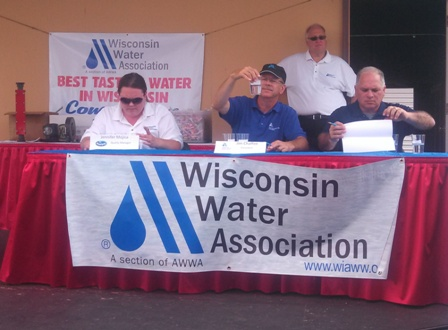 Judges examine water samples at Water Taste Test
