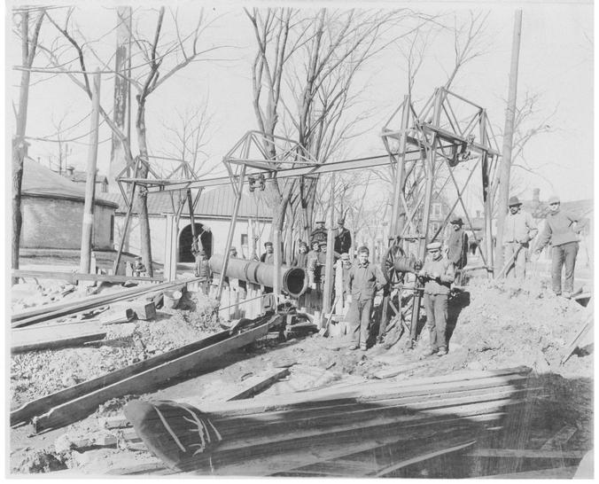Crew preparing to lay water main pipe in Madison in the late 1800s
