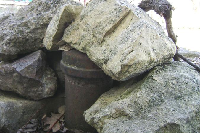 Private well under rocks