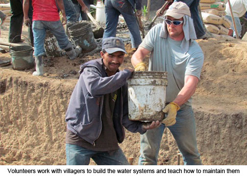 Volunteers work with villagers to build the water systems and teach how to maintain them