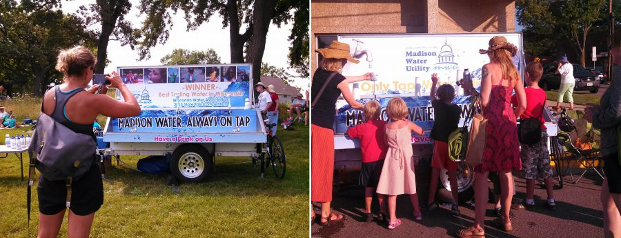 Woman takes photo of Water Wagon and people refill bottles